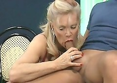 Chocolate chick shares a stiff cock with a horny blonde MILF