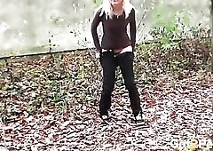Small tits blonde cutie caught pissing outdoors