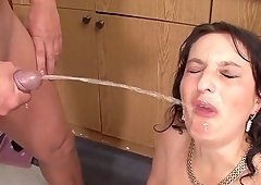 Brunette milf Katyka Gabor getting a big cock and pee on her face