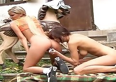 Cynthia Fox and Mellie are outdoors taking off their shirts allowing