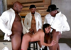 Curly haired bimbo gets gangbanged by four hunky black dudes