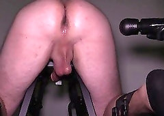 Sexy masseuse in black gloves stimulates his ass and dick