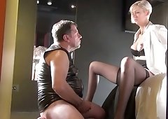 Blond hooker in stockings spreads legs wide open and shows pierced pussy