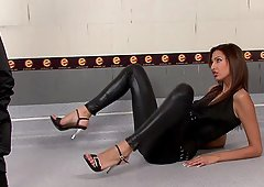 Beautiful brunette in leather pants teasing during a photo shoot