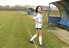Kicking the ball around and fingering her cunt outside