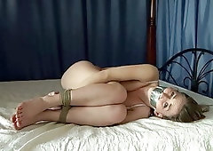 Beauty hogtied nude in the bed