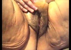 Mature whorable lady with enormous ass flashes her disgusting cunt
