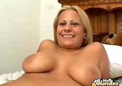 Busty blonde seductress Casey Cole showing her small pink pussy