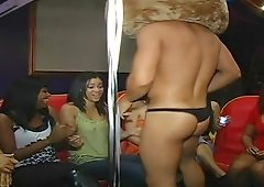 Stripper removes his costume at a party and cums on some large tits