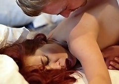 Beautiful redhead has passionate lovemaking session with a hunk