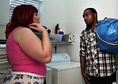 Fat redhead receives a fierce drilling from her black neighbor