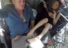 Taboo milf gives footjob to guy in car