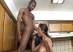 Natural tits wife giving big black cock blowjob in the kitchen