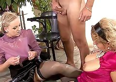 Babes enjoy a golden shower during a great threesome game