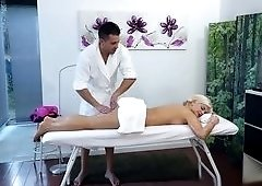 Blonde pounded on by her horny masseur