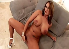 Voluptuous Trina Michaels finger fucks her slippery pussy