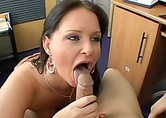 Maya Divine gives head & strokes the dick for jizz in the office