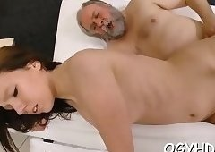 Redhead hottie licked by old dude