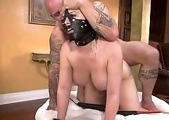 A Black Leather Mask On Her Face And A Fat Dick In Her Pussy
