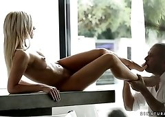 Magnificent and fresh blonde white model seduces and fucks on the table