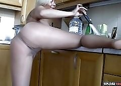 Blonde in Pantyhose gets wild in the kitchen