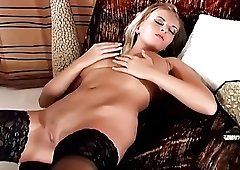 Glamour babe in sexy lingerie rubbing her pussy