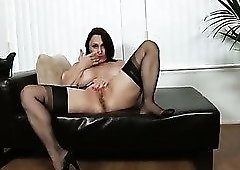 Long legged whore in black tights Jillian Foxxx tickles her shaved pussy