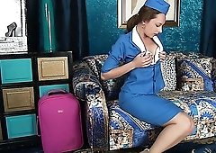 Horny alone flight attendant Claire Adams undresses and plays with pussy