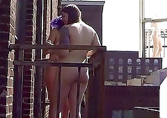 Two sex-loving girls are posing completely naked on the balcony