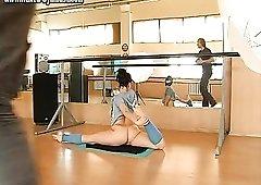 Naked girl is flexible in the ballet studio