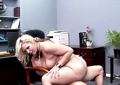 A blonde with large tits is getting rammed in the office