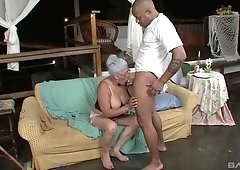 Horny cougar Eva gets her hairy pussy banged by a dark cock