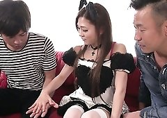 Ardent Japanese maid Maki Horiguchi works on two strong cocks at once