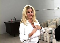 Business MILF Penny Porsche whips her big tits out and services two guys
