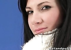 Brunette teen teases in furry white coat