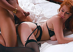 Elegant redhead Penny Pax gets cum on her ass from a black dick