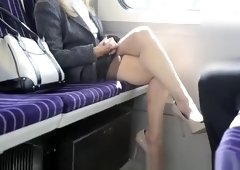 Blonde woman spreads legs in train
