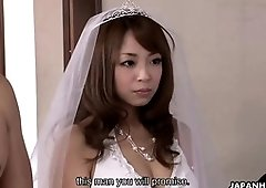 Japanese bride is sucking cock during the wedding ceremony, while guests is watching her in action