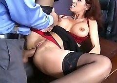 Redheaded MILF beauty gets fucked with her stockings on